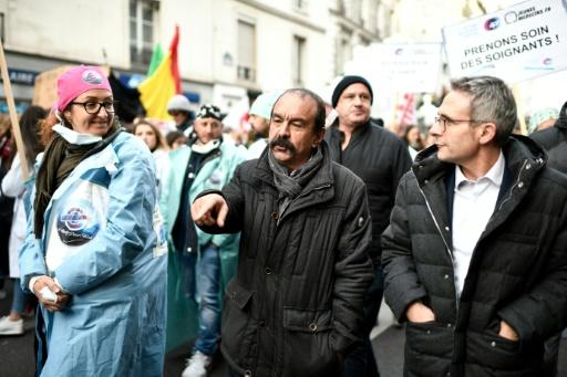 "Philippe Martinez, centre, head of France's CGT labour union, at a hospital workers strike in Paris in November. He called the government's pension reform plan a ""flagrant provocation."""