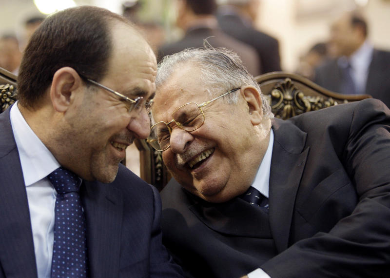 FILE - In this June. 27, 2009 file photo, Iraq's Prime Minister Nouri al-Maliki, left, and President Jalal Talabani, right, react, at a ceremony marking the death of Mohammed Baqir al-Hakim in Baghdad, Iraq. President Jalal Talabani's departure from Iraq's political life comes at a worse time for his troubled nation, under threat from mounting tensions between Kurds, Sunnis and Shiites. (AP Photo/Hadi Mizban, File)