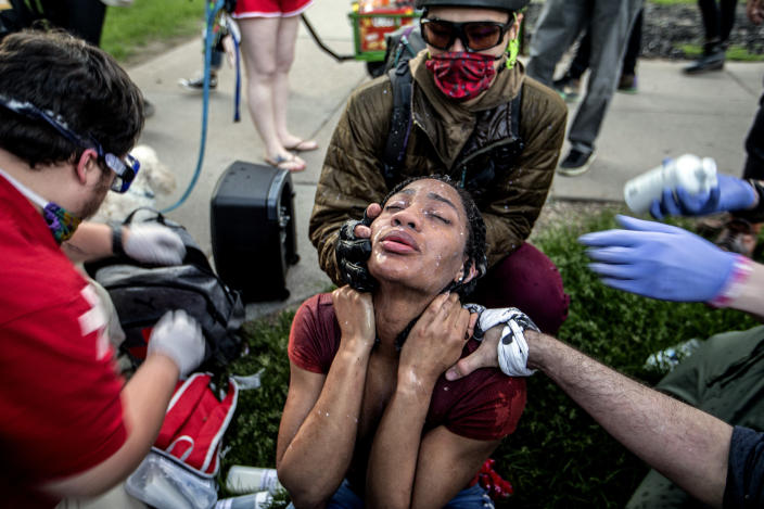 A protester receives care from street medics in Minneapolis, Saturday, May 30, 2020. Protests continue across the country over the death of George Floyd, a black man who died after being restrained by Minneapolis police officers on May 25. (Khadejeh Nikouyeh/News & Record via AP)/News & Record via AP)