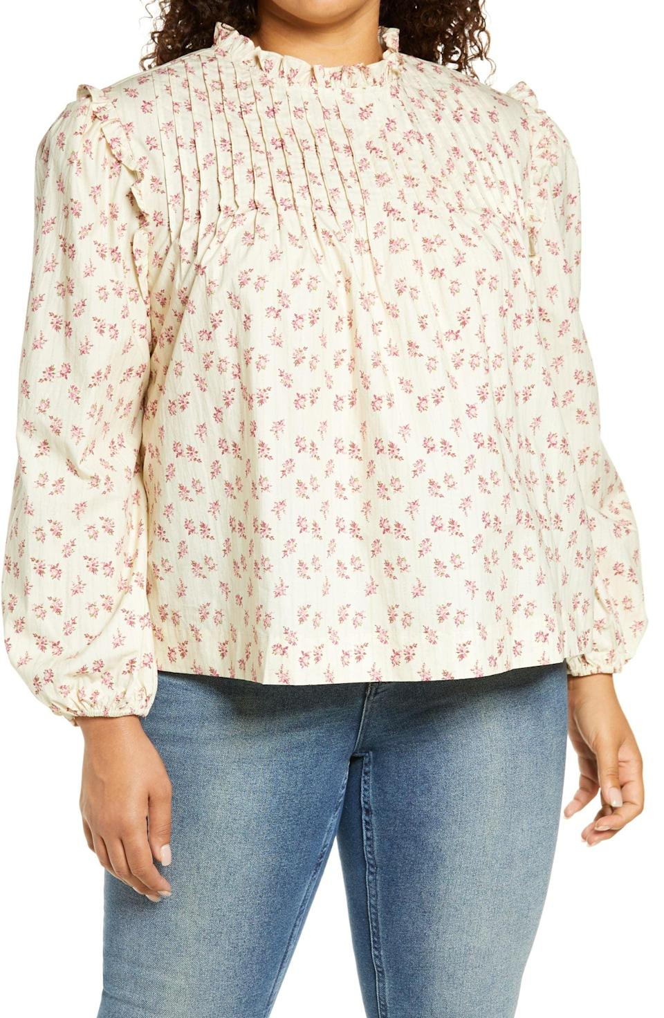 <p>We're into the print on this <span>Wayf Linford Floral Pintuck Top</span> ($34, originally $68).</p>