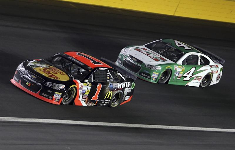 Jamie McMurray (1) leads Kevin Harvick (4) in Turn 2 in the closing laps of the NASCAR Sprint All-Star auto race at Charlotte Motor Speedway in Concord, N.C., Saturday, May 17, 2014