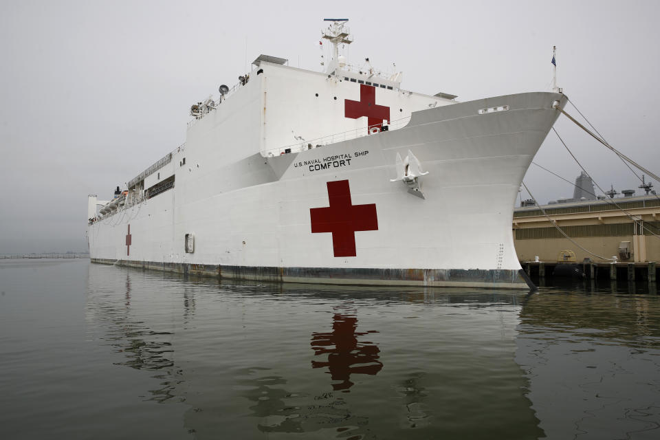 The U.S. Navy hospital ship USNS Comfort is docked at Naval Station Norfolk in Norfolk, Va., Saturday, March 28, 2020. The ship set to depart for New York to assist hospitals responding to the coronavirus outbreak. (AP Photo/Patrick Semansky)