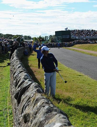 """<h1 class=""""title"""">Old Course At St. Andrews</h1> <div class=""""caption""""> <p><strong>Where:</strong> St Andrews, Scotland</p> <p><strong>Times hosting:</strong> 29, including this year</p> <p><strong>You know it as:</strong> """"The Home of Golf."""" There's not much more to say than that.</p> <p><strong>Unique features:</strong> The """"Road Hole"""" (<em>left</em>), on which a road and a hotel come into play; Swilcan Bridge (think Jack Nicklaus waving goodbye); Hell Bunker, large double greens, Valley of Sin, etc.</p> <p><strong>Noteworthy moments:</strong> This course has so much history that five players (Bob Martin, J.H. Taylor, James Braid, Jack Nicklaus and <a class=""""link rapid-noclick-resp"""" href=""""/pga/players/147/"""" data-ylk=""""slk:Tiger Woods"""">Tiger Woods</a>) have won two Open titles there. None were more impressive than Woods' eight-shot romp in 2000, though, when his 19-under-par total set a major championship record. Five years later, Woods would win again here during a week that also saw Jack Nicklaus play in his final major.</p> </div>"""