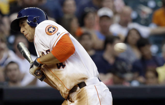 Houston Astros' George Springer dodges a close pitch in the sixth inning of a baseball game against the Oakland Athletics, Saturday, April 26, 2014, in Houston. (AP Photo/Pat Sullivan)