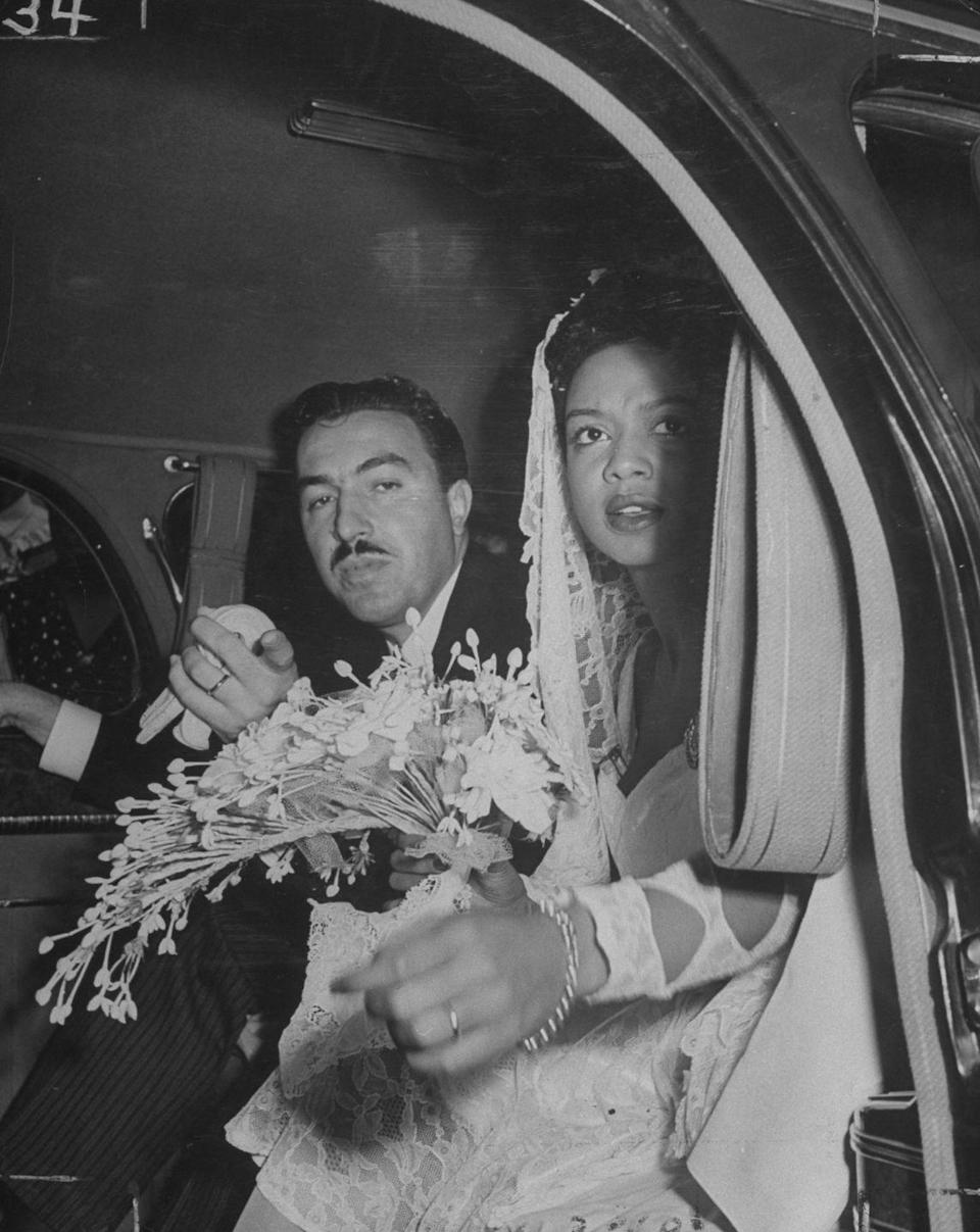 """<p>The marriage of jazz musician Hazel Scott and U.S. Congressman Adam Clayton Powell Jr. was one of New York's biggest society weddings in 1945. After a church ceremony—which Scott wore a knee-length white lace dress to—the couple held a <a href=""""http://content.time.com/time/subscriber/article/0,33009,792296,00.html"""" rel=""""nofollow noopener"""" target=""""_blank"""" data-ylk=""""slk:reception at the nightclub Cafe Society"""" class=""""link rapid-noclick-resp"""">reception at the nightclub Cafe Society</a>, which drew thousands of guests. The couple was <a href=""""https://time.com/4507850/hazel-scott/"""" rel=""""nofollow noopener"""" target=""""_blank"""" data-ylk=""""slk:married until 1960"""" class=""""link rapid-noclick-resp"""">married until 1960</a>, but separated in 1957. </p>"""