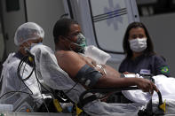 A 41-year-old patient suspected of having COVID-19 arrives from an ambulance to the HRAN public hospital in Brasilia, Brazil, Wednesday, April 14, 2021. (AP Photo/Eraldo Peres)