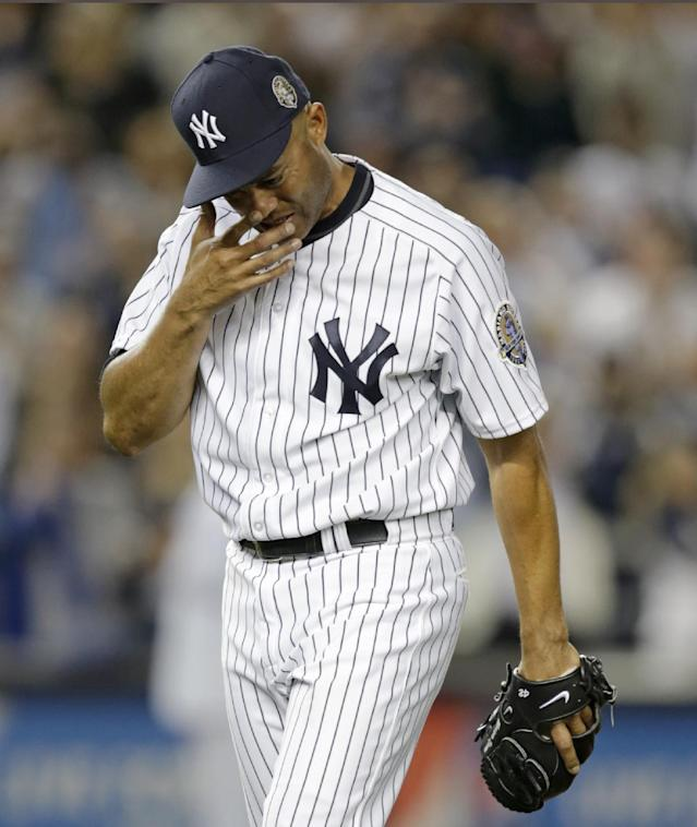 CORRECTS WINNING TEAM - New York Yankees relief pitcher Mariano Rivera cries coming off the mound with two outs in the ninth inning of his final appearance in a baseball game at Yankee Stadium, Thursday, Sept. 26, 2013, in New York. The Tampa Bay Rays won 4-0. (AP Photo/Kathy Willens)
