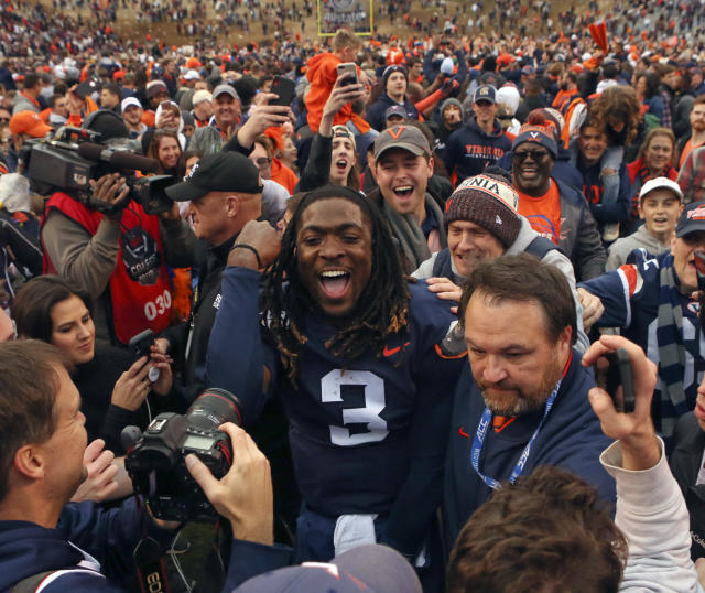 Virginia quarterback Bryce Perkins (3) celebrates with fans after their 39-30 win over Virginia Tech in an NCAA college football game Friday, Nov. 29, 2019, in Charlottesville Va. (Matt Gentry/The Roanoke Times via AP)