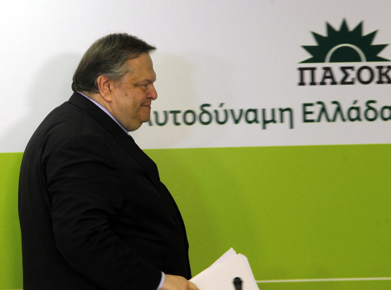 Greece's socialist leader, Evangelos Venizelos of the PASOK party leaves the podium after his statements in Athens on Sunday, May 6, 2012. Greece's former finance minister and Socialist party leader called for a broad coalition government of pro-European parties, ruling out a two-party government with his conservative rivals after his party received a drubbing in Sunday's parliamentary elections. The banner reads ''Self-sufficient Greece, PASOK.'' (AP Photo/Eurokinissi, Christos Bonis) GREECE OUT