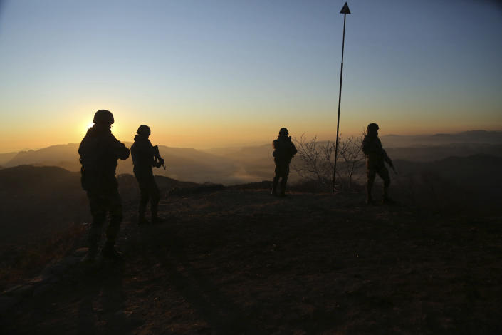 Indian army soldiers patrol at the Line of Control (LOC) between India and Pakistan border in Poonch, about 250 kilometers (156 miles) from Jammu, India, Thursday, Dec. 18, 2020. From sandbagged Indian army bunkers dug deep into the Pir Panjal mountains in the Himalayas, villages on the Pakistan-controlled side of Kashmir appear precariously close, on the other side of the Line of Control that for the past 73 years has divided the region between the two nuclear-armed rivals. Tens of thousands of soldiers from India and Pakistan are positioned along the two sides. The apparent calm is often broken by the boom of blazing guns, with each side accusing the other of initiating the firing. (AP Photo/Channi Anand)