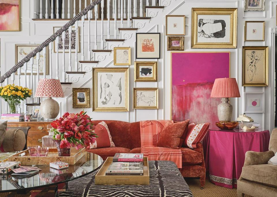 """<p>Growing up with a father who is an interior designer, <a href=""""https://www.lantzcollective.com/"""" rel=""""nofollow noopener"""" target=""""_blank"""" data-ylk=""""slk:Amanda Lantz"""" class=""""link rapid-noclick-resp"""">Amanda Lantz</a> has been looking at fabrics since she was six-years old and always knew being a part of the Kips Bay Decorator Show House was a dream of hers. Upon receiving this Dallas family room to redesign in support of the Kips Bay Boys & Girls Club, she imagined a lively, bright space where technology had no importance and analog reigned supreme.</p><p>""""I wanted to create a comfortable and relaxed space that was very colorful,"""" says Lantz. """"I felt like the room was too beautiful to put a television in there, and as I was ruminating about the path of design, I kept thinking about the way we've been living lately and how all this technology has become too important. I wanted to create a retreat from all of that, a space filled with a gorgeous collection of my dad's art."""" </p><p>Besides the gorgeous gallery walls, Lantz says one of the main focal points is the stunning fireplace from <a href=""""https://strikefireplaces.com/"""" rel=""""nofollow noopener"""" target=""""_blank"""" data-ylk=""""slk:Strike"""" class=""""link rapid-noclick-resp"""">Strike</a> by Chad Dorsey. A custom digital wallpaper by Kravet enlivens the space while an array of vintage pieces keeps the room feeling rooted and of historical importance. The first piece Lantz collected for this space was a gorgeous daybed from Tara Shaw that helped set the tone for the room's design. Meanwhile, her lifetime love of fabrics rose to full display in a variety of pattern, color, and texture, creating an inviting place to spend an afternoon playing cards or just enjoying conversation over cocktails. The space feels both sophisticated and family-friendly at the same time thanks to the pops of color, vintage pieces, and gallery walls. </p>"""