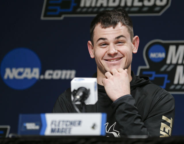 Wofford's Fletcher Magee answers questions during a news conference at the NCAA mens college basketball tournament in Jacksonville, Fla., Friday, March 22, 2019. Wofford faces Kentucky in the second round on Saturday. (AP Photo/Stephen B. Morton)