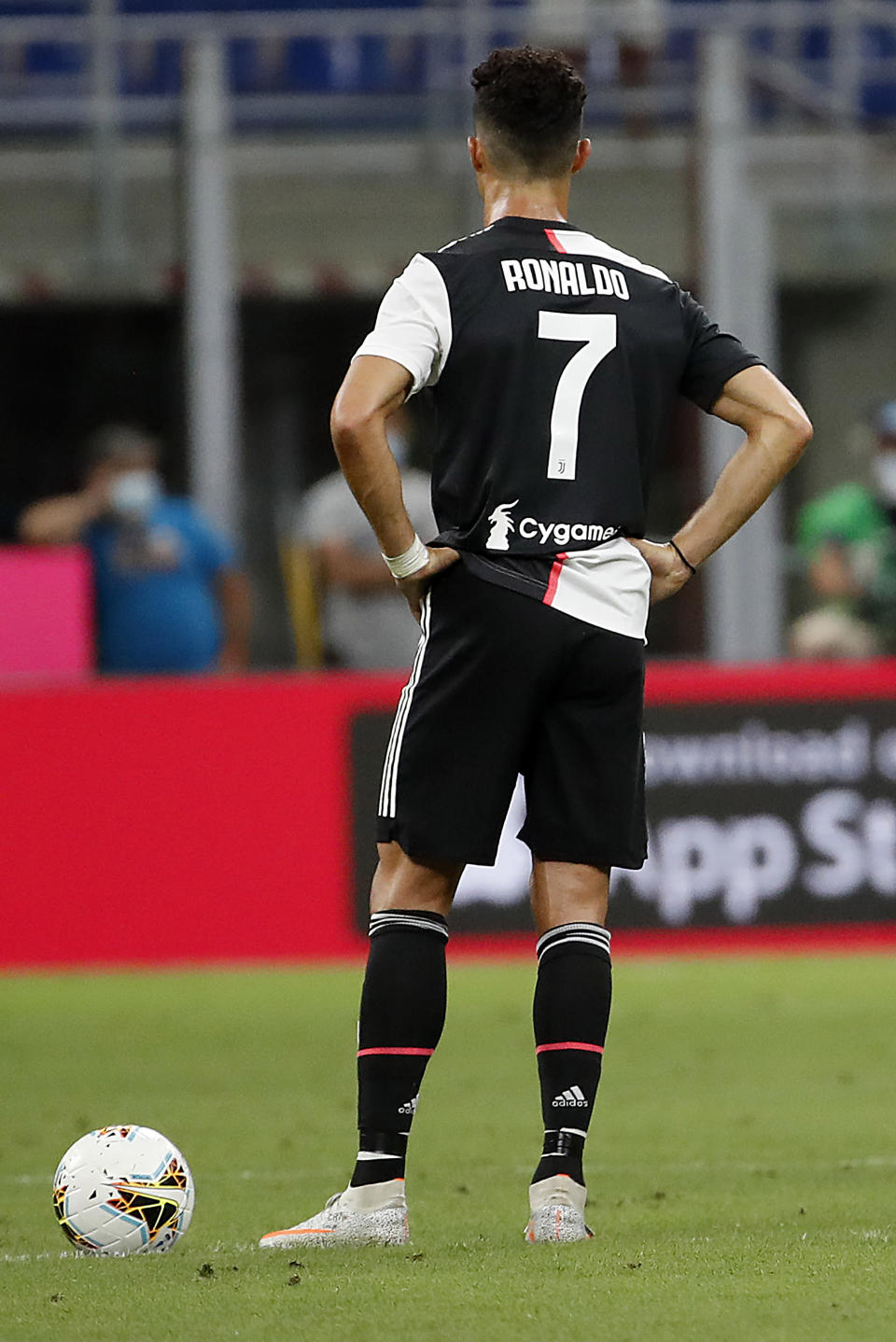 Juventus' Cristiano Ronaldo, left, reacts after AC Milan's Ante Rebic scores against Juventus during the Serie A soccer match between AC Milan and Juventus at the San Siro stadium, in Milan, Italy, Tuesday, July 7, 2020. (AP Photo/Antonio Calanni)