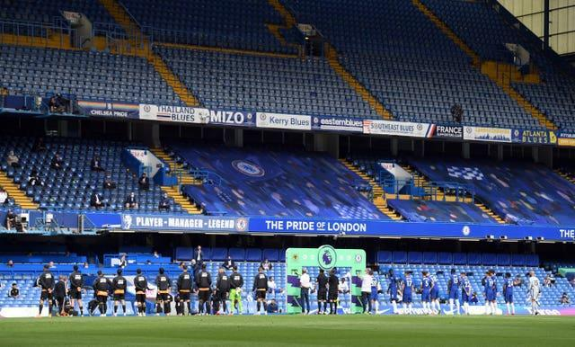 Chelsea and Wolves line up in front of empty stands at Stamford Bridge