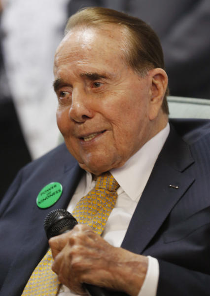 Former Sen. Bob Dole, R-Kan., talks to a crowd gathered at Johnson County Republican Headquarters in Overland Park, Kan., Monday, April 21, 2014. (AP Photo/Orlin Wagner)