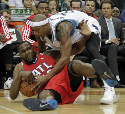Atlanta Hawks forward Elton Brand (42) battles Minnesota Timberwolves forward Dante Cunningham (33) for the loose ball during the first half of an NBA basketball game, Wednesday, March 26, 2014, in Minneapolis. (AP Photo/Paul Battaglia)