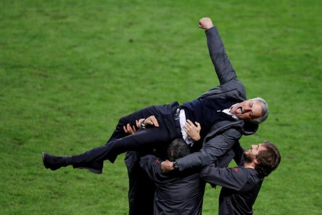 FILE PHOTO: Manchester United manager Jose Mourinho celebrates with coaching staff after the club's 2-0 victory over Ajax Amsterdam in the Europa League final in Stockholm.
