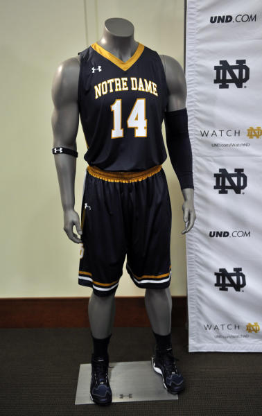 A new Notre Dame basketball uniform is displayed at a news conference Tuesday Jan. 21, 2014 in South Bend, Ind., announcing an agreement between Notre Dame and Under Armour that will outfit the university's athletic teams (AP Photo/Joe Raymond)
