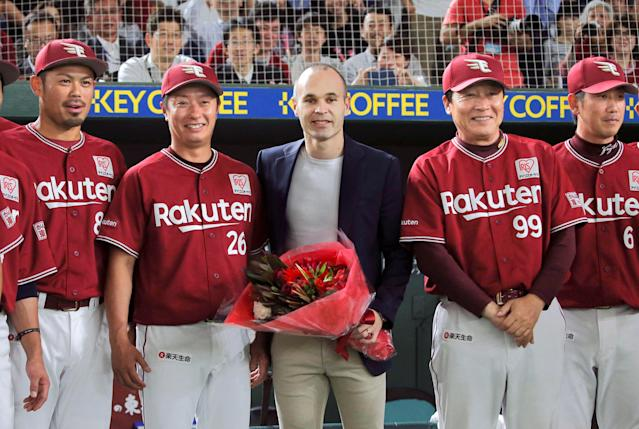 Spain midfielder Andres Iniesta, who signed for Japanese side Vissel Kobe, poses with Japan's professional baseball team Tohoku Rakuten Golden Eagles manager Masataka Nashida and players at Tokyo Dome in Tokyo, Japan, in this photo taken by Kyodo May 24, 2018. Mandatory credit Kyodo/via REUTERS ATTENTION EDITORS - THIS IMAGE WAS PROVIDED BY A THIRD PARTY. MANDATORY CREDIT. JAPAN OUT. NO COMMERCIAL OR EDITORIAL SALES IN JAPAN.