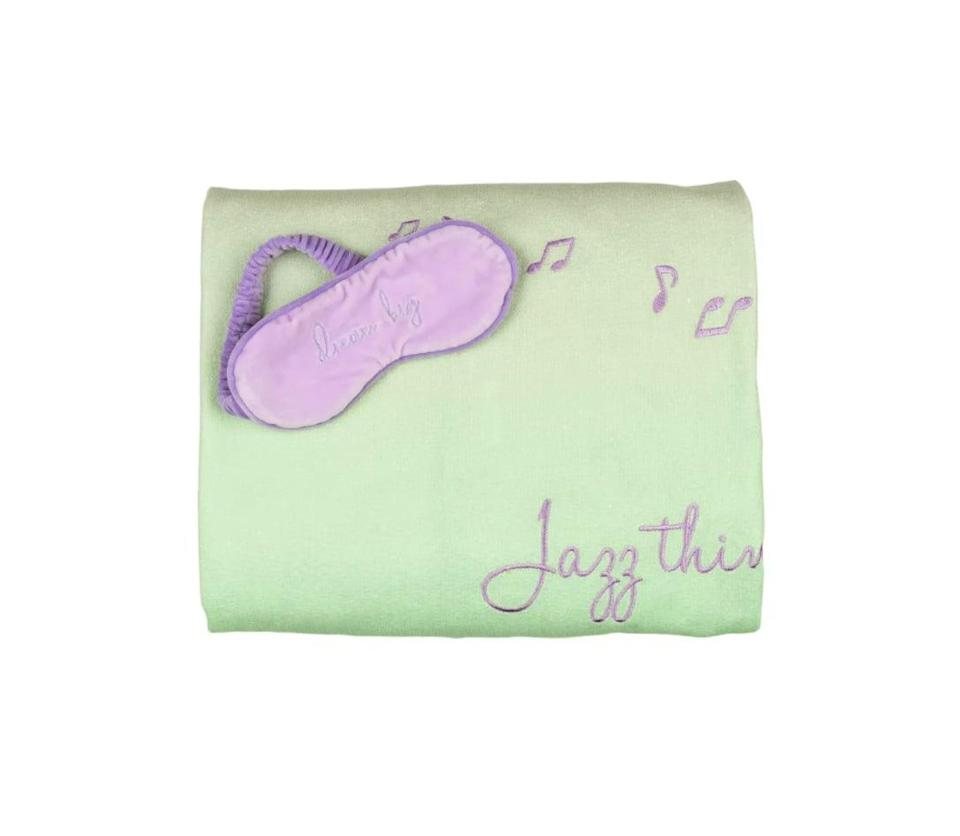 """<p>""""Jazz Things Up"""" and """"Dream Big"""" with this cozy <span>Disney Princess X POPSUGAR Tiana Chenille Throw and Eye Mask</span> ($30) set that comes in a fun pastel take on the Mardi Gras colors of purple and green.</p>"""