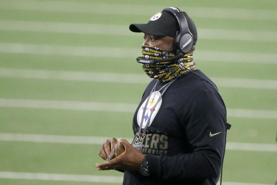 Pittsburgh Steelers head coach Mike Tomlin watches play against the Dallas Cowboys in the second half of an NFL football game in Arlington, Texas, Sunday, Nov. 8, 2020. (AP Photo/Michael Ainsworth)