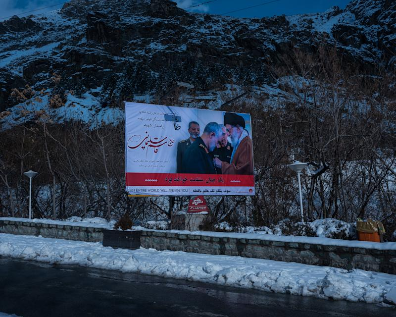 A poster showing Soleimani and the Supreme Leader, Ayatollah Ali Khamenei, in the snowy mountains above Iran's capital. | Newsha Tavakolian—Magnum Photos for TIME