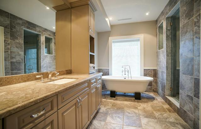 <p>There are seven bathrooms in the home, although the master suite definitely offers the best view. (Listing via <span>Royal LePage</span>) </p>