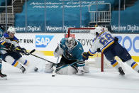San Jose Sharks goaltender Devan Dubnyk (40) blocks a shot as St. Louis Blues left wing Mike Hoffman (68) and left wing Sammy Blais, left, attack during the second period of an NHL hockey game in San Jose, Calif., Saturday, Feb, 27, 2021. (AP Photo/Tony Avelar)