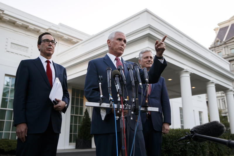 Vice President Mike Pence, with Treasury Secretary Steven Mnuchin, left, and national security adviser Robert O'Brien, speaks to reporters outside the West Wing of the White House, Monday, Oct. 14, 2019, in Washington. The U.S. is calling for an immediate ceasefire in Turkey's strikes against Kurds in Syria, and is sending Pence to lead mediation effort (AP Photo/Jacquelyn Martin)