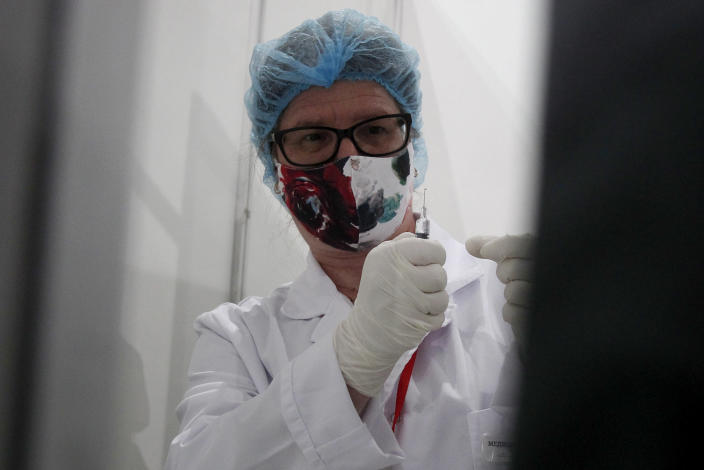 A nurse prepares a COVID-19 vaccine, at the center for mass vaccination against COVID-19, at A1 Arena in Skopje, North Macedonia, on Tuesday, May 4, 2021. The European Union started delivering EU-funded coronavirus vaccines Tuesday to the Balkans, a region that wants to join the 27-nation bloc but where China and Russia have already been supplying the much-needed shots and making political gains. (AP Photo/Boris Grdanoski)