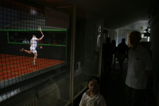 Ben Taylor-Matthews plays in a match at the Real Tennis Champions Trophy at Hampton Court Palace, south-west London