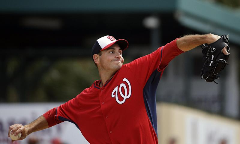 Washington Nationals starting pitcher Chris Young throws in the first inning of an exhibition spring training baseball game against the St. Louis Cardinals, Saturday, March 8, 2014, in Jupiter, Fla. (AP Photo/David Goldman)