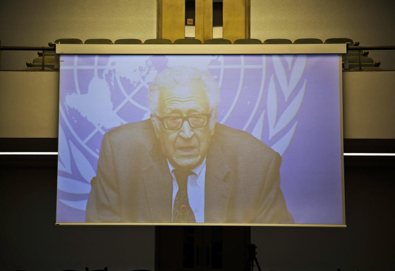 U.N. mediator Lakhdar Brahimi is pictured on a giant screen as his press briefing is fed live to the interim press working space at the United Nations headquarters in Geneva, Switzerland, Tuesday, Jan. 28, 2014. Negotiations between Syrian negotiators broke off earlier than planned Tuesday amid mutual accusations and the government's anger over the resumption of U.S. aid to the opposition. (AP Photo/Anja Niedringhaus)