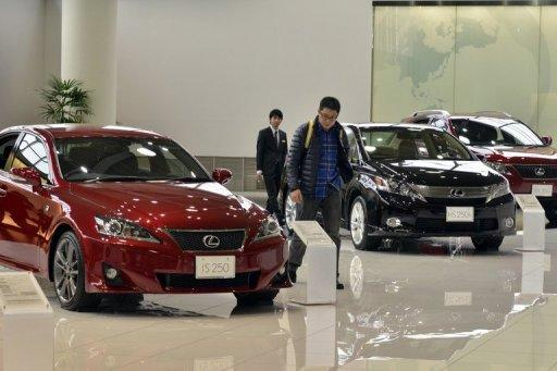 A customer inspects Toyota's Lexus brand vehicles at Toyots'a showroom in Tokyo