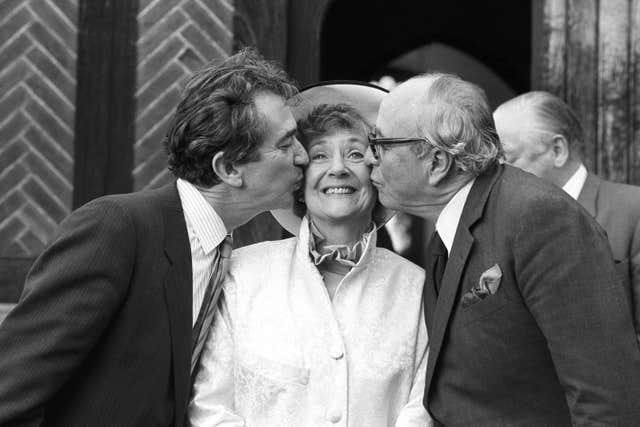 SDP president Shirley Williams receiving a kiss from fellow founding members of the party Bill Rodgers (left) and Lord Jenkins, outside the Church of St Edmunds following her wedding to American professor Richard Neustadt in 1987