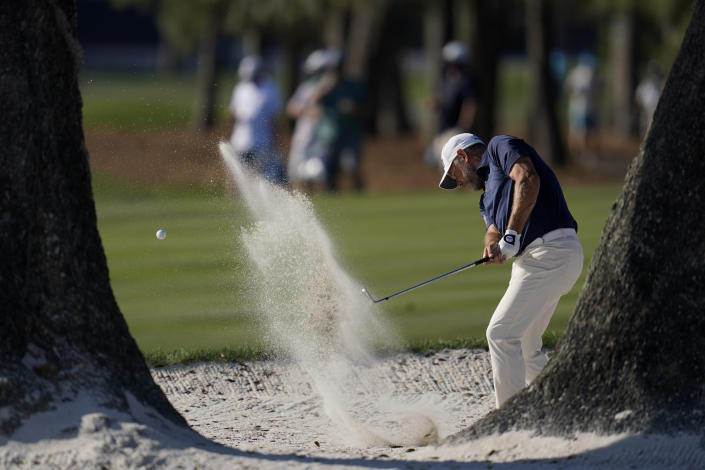 Lee Westwood, of England, hits from the bunker on the 16th hole during the final round of The Players Championship golf tournament Sunday, March 14, 2021, in Ponte Vedra Beach, Fla. (AP Photo/Gerald Herbert)