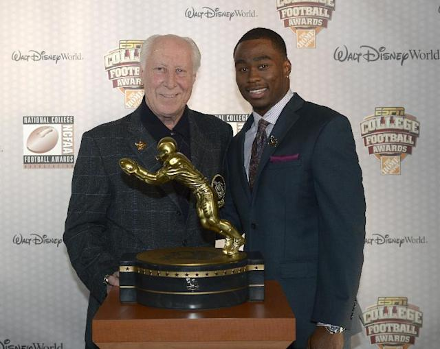 Oregon State receiver Brandin Cooks, right, poses with Fred Biletnikoff and the Biletnikoff Award after winning the honor during the College Football Awards show in Lake Buena Vista, Fla., Thursday, Dec. 12, 2013. (AP Photo/Phelan M. Ebenhack)