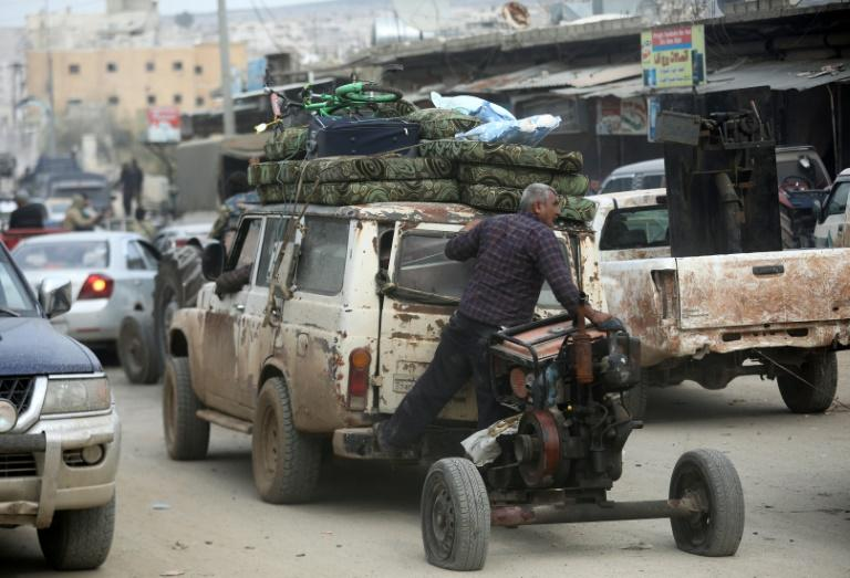 Civilians flee the Syrian Kurdish city of Afrin any way they can as Turkish troops and their Syrian Arab allies overrun it on March 18, 2018