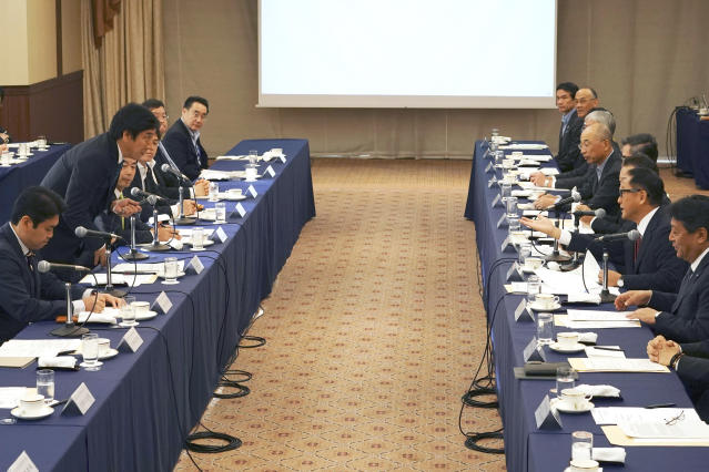 CORRECTS COMPANY NAME TO TOYOTA MOTOR CORP. - Akio Toyoda, center right, president and CEO of Toyota Motor Corp., with a group of the Japanese automakers chiefs, speaks to Japanese Trade Minister Isshu Sugawara, left standing, during a meeting Thursday, Sept. 26, 2019, in Tokyo. The U.S. and Japan on Wednesday signed a limited trade deal that will eliminate tariffs and expand market access on farm, industrial and digital products. But the deal does not address autos, a key sticking point during months of contentious negotiations, and President Donald Trump indicated the two countries were still working on a broader agreement. (AP Photo/Eugene Hoshiko)