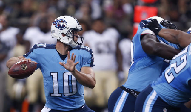 Tennessee Titans quarterback Jake Locker (10) passes in the first half of an NFL football game against the New Orleans Saints in New Orleans, Friday, Aug. 15, 2014. (AP Photo/Rogelio Solis)