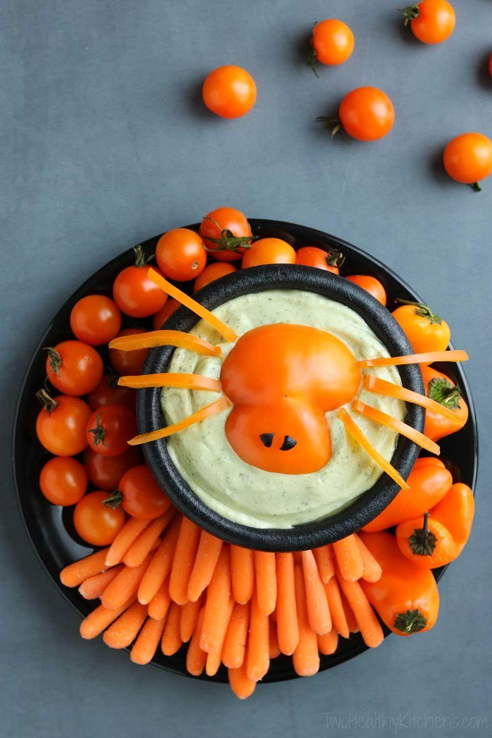 """<p>On the hunt for some delicious finger foods? A cleverly cut bell pepper makes a dip topper fit for a crowd.</p><p><a class=""""link rapid-noclick-resp"""" href=""""https://twohealthykitchens.com/halloween-appetizer-dip-spooky-spider/"""" rel=""""nofollow noopener"""" target=""""_blank"""" data-ylk=""""slk:GET THE RECIPE"""">GET THE RECIPE</a> </p>"""