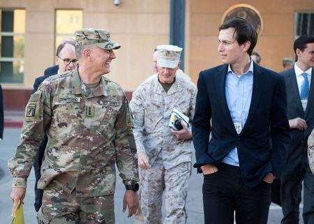 Jared Kushner, Senior Advisor to President Donald J. Trump, speaks with Lt. Gen. Stephen J. Townsend, commander, Combined Joint Task Force – Operation Inherent Resolve, after arriving in Baghdad, Iraq, in this April 3, 2017 handout photo. Navy Petty Officer 2nd Class Dominique A. Pineiro/DoD/Handout via REUTERS