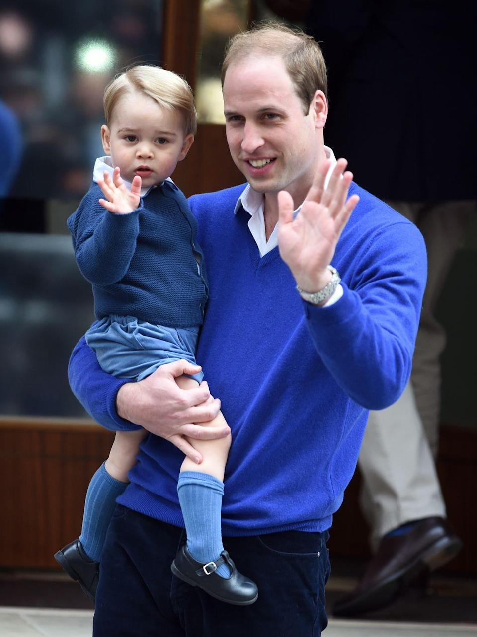 <p>George and William wave to the press at the Lindo Wing at St. Mary's Hospital shortly after the birth of Princess Charlotte in May 2015. George is currently third-in-line to the throne, after dad William (second) and grandpa Charles (first).</p>