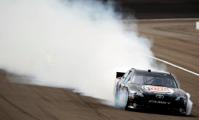 LAS VEGAS, NV - MARCH 11: Smoke flies from the #93 Burger King Toyota, driven by Travis Kvapil, after an incident in the NASCAR Sprint Cup Series Kobalt Tools 400 at Las Vegas Motor Speedway on March 11, 2012 in Las Vegas, Nevada. (Photo by Todd Warshaw/Getty Images for NASCAR)