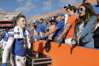 Florida quarterback Kyle Trask, left, high-fives fans after defeating Vanderbilt in an NCAA college football game, Saturday, Nov. 9, 2019, in Gainesville, Fla. (AP Photo/John Raoux)