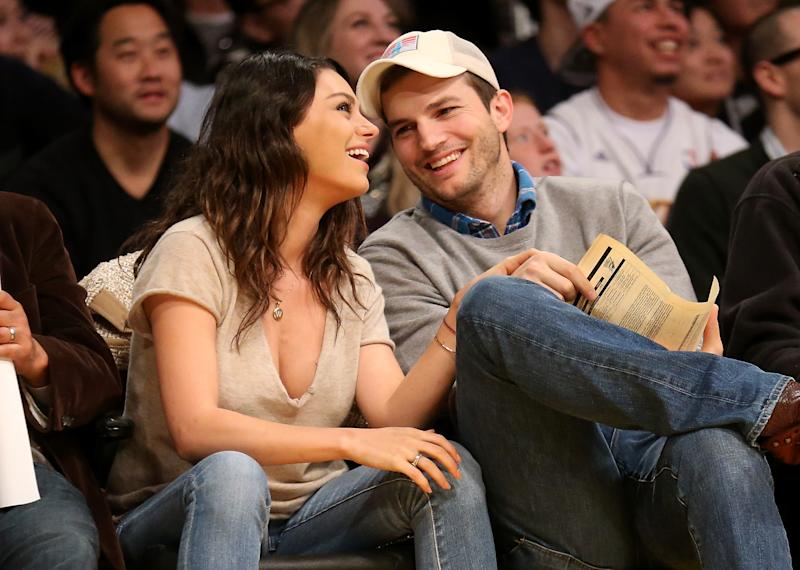 Kutcher and Kunis at a basketball game in 2014: Stephen Dunn/Getty Images