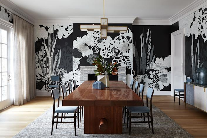 "<div class=""caption""> ""This is my favorite room in the house,"" says Story of the dining room, where a custom wall installation by artist Amy Kao injects a playful dose of personality. The sheen lacquer of the custom <a href=""https://www.jeromeabelseguin.com/"" rel=""nofollow noopener"" target=""_blank"" data-ylk=""slk:Jerome Abel Seguin"" class=""link rapid-noclick-resp"">Jerome Abel Seguin</a> table offsets the wood construction of vintage Gio Ponti chairs upholstered in <a href=""https://www.claremontfurnishing.com/"" rel=""nofollow noopener"" target=""_blank"" data-ylk=""slk:Claremont"" class=""link rapid-noclick-resp"">Claremont</a> velvet and a marble, leather, and brass credenza by <a href=""https://www.oriorfurniture.com/"" rel=""nofollow noopener"" target=""_blank"" data-ylk=""slk:Orior Furniture"" class=""link rapid-noclick-resp"">Orior Furniture</a>. The antique alabaster-and-brass chandelier is from <a href=""https://www.bgoecklerantiques.com/"" rel=""nofollow noopener"" target=""_blank"" data-ylk=""slk:Bernd Goeckler"" class=""link rapid-noclick-resp"">Bernd Goeckler</a>. </div>"