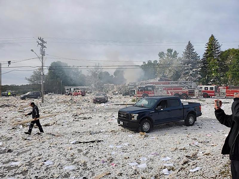 A man works at the scene of a deadly propane explosion on Sept. 16, 2019, which leveled new construction in Farmington, Maine. The explosion leveled a new building, which housed a nonprofit.