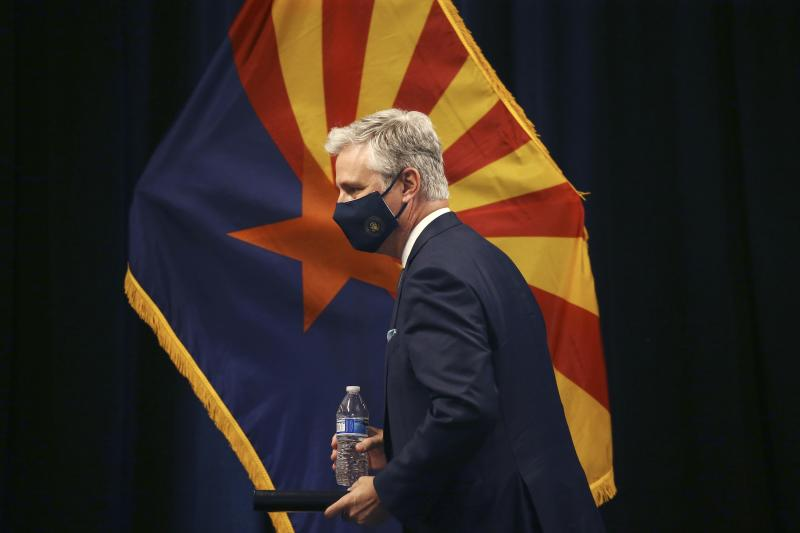 Robert O'Brien, assistant to the president for national security affairs, walks to the podium to speak during a news conference regarding China Wednesday, June 24, 2020, in Phoenix. (AP Photo/Ross D. Franklin)