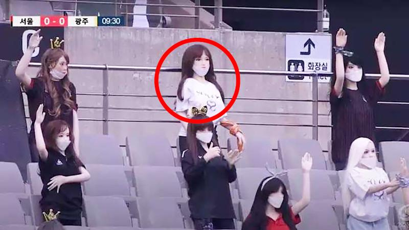 A screenshot from the K-League broadcast shows the lifelike sex dolls in the stands.